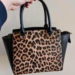 Barely used leopard purse with removable straps